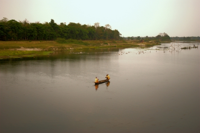 majuli brahmaputra river assam - two men and a boat