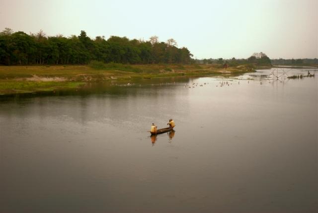 majuli brahmaputra river assam - two men and a boat