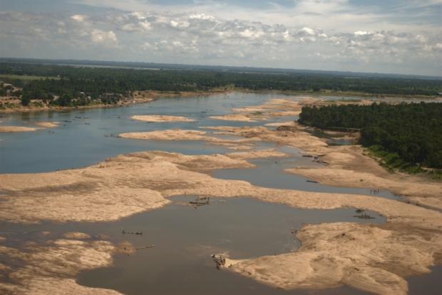 Dawki River forms a vast riverbed in Bangladesh.