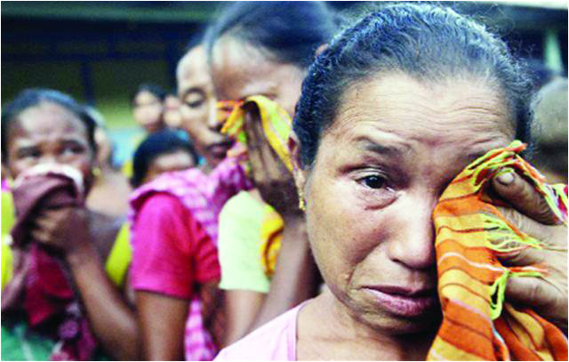 large-Bodo women cry at a relief camp at Bhot Gaon village after ethnic clashes in Assam (1)