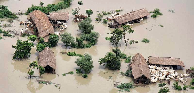 assam climate change (floods) impact on population-communities