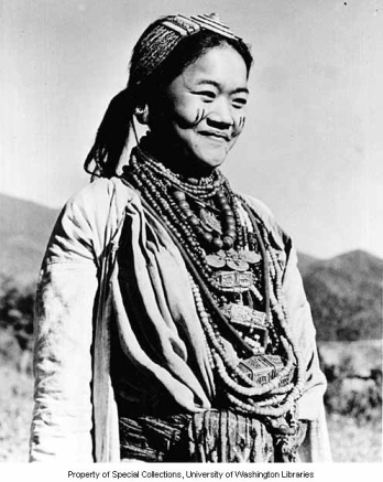 Aka woman with face paint and tibetan ornaments jamiri village india