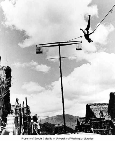 An Apatani man performing bobo, or rope swinging, during Myoko spring festival, Hari village, Arunachal Pradesh. Year: 1954 University of Washington Libraries