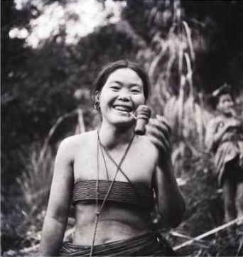 A Hill Miri woman wearing the characteristic cane brassiere, Subansiri Valley, Arunachal Pradesh.