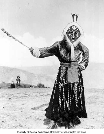 Monpa dancer wearing felt mask with cowrie shells, Shyo village, Northeast Frontier Agency, India, ca. 1954