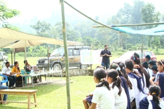 Discussing the benefits of tourism with villagers at Namdapha National Park