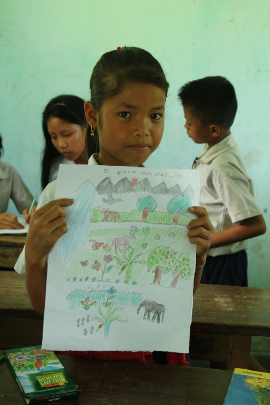 One of the students with her painting