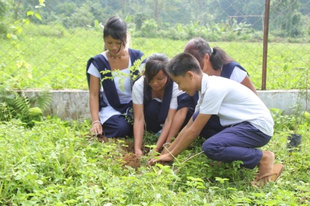Tree planting with village children of Namdapha National Park, Arunachal Pradesh