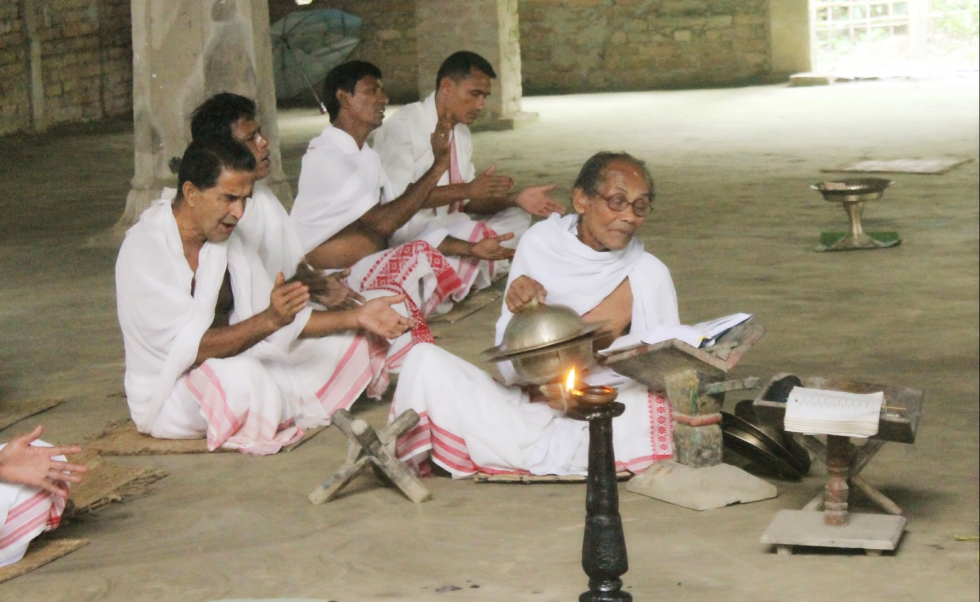 Monks praying and chanting at a Hindu Monastery in Majuli Island, Assam