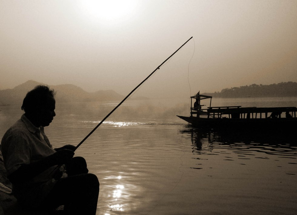 A man fishing on the bank of Brahmaputra at Sukreswar Mandir, Guwahati at the time of Sunset on Saturday.